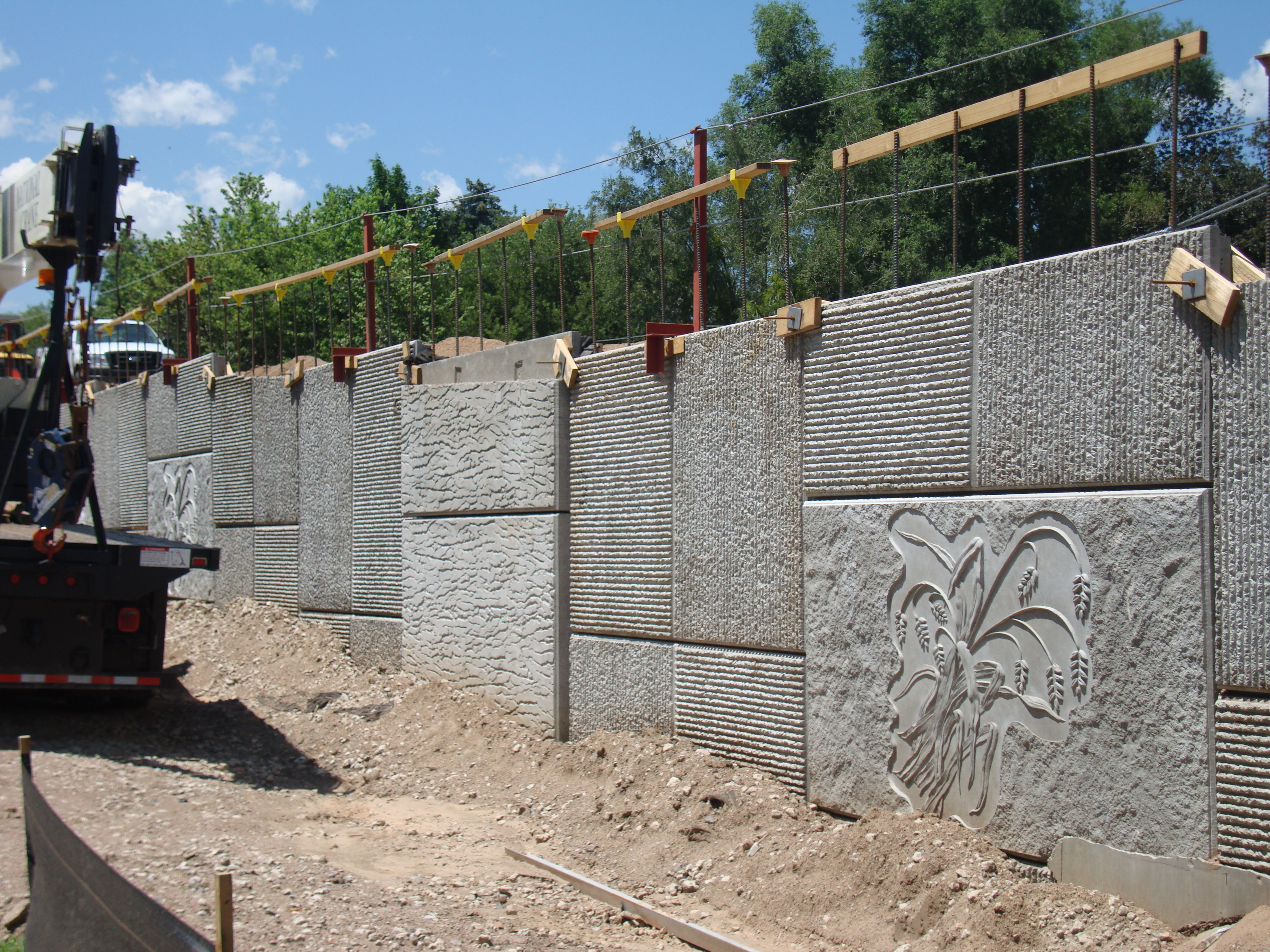 Mse Panels Featuring Concrete Textures Piece Together To Form A Retaining Wall Concrete Retaining Walls Concrete Art Concrete Texture