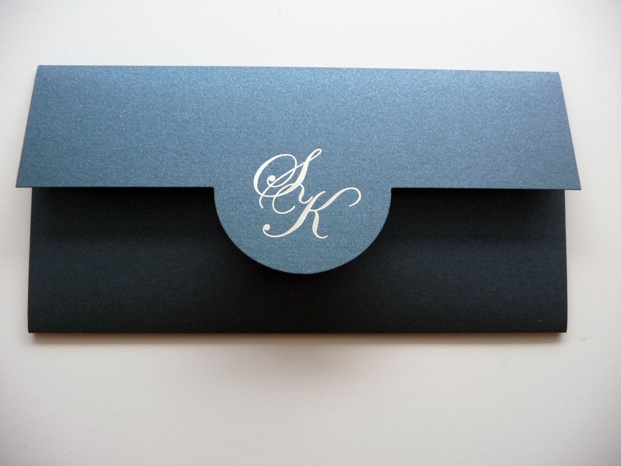 Personalised initials foiled onto the cover of a pocket wallet style ...