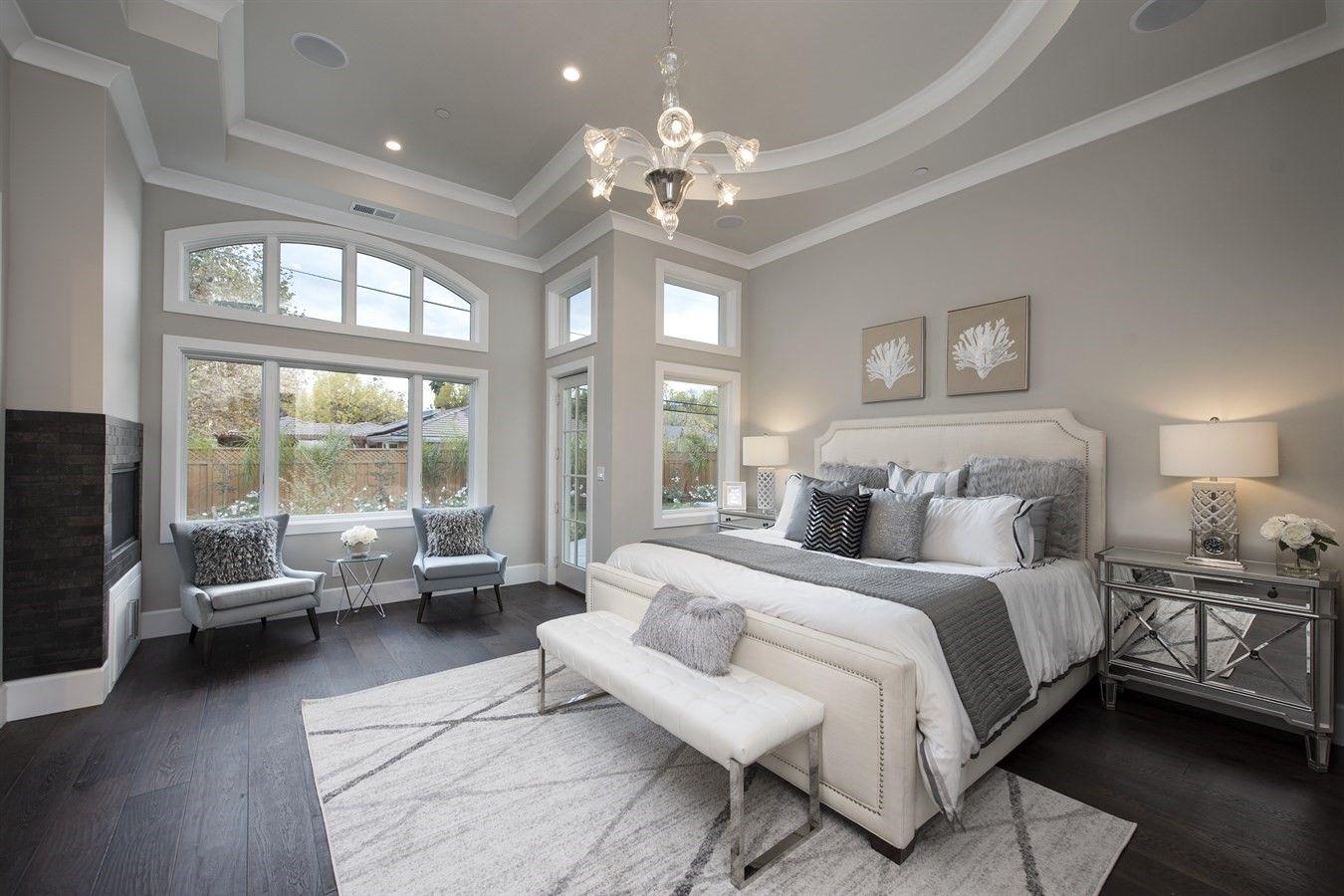 Huge bedroom with unique light fixtures, romantic ...