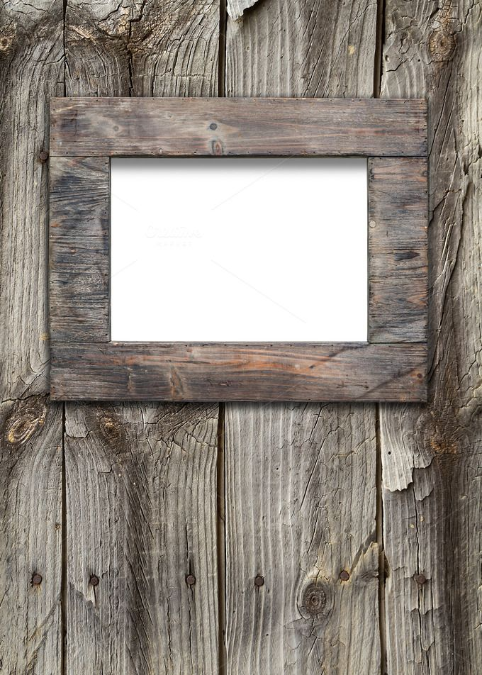 Empty frame on wooden surface | Empty frames