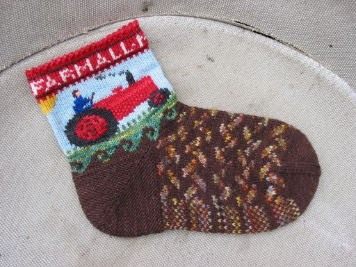 Tractor Socks, knit in Celestial Merino yarn.  Also available as a kit from my website: http://lucyneatby.com/index.php?specific=1000711