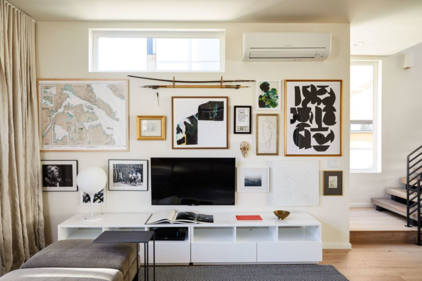 The family's gallery wall is constantly morphing, incorporating everything from sketches, photographs, spears, maps, and even animal skulls!