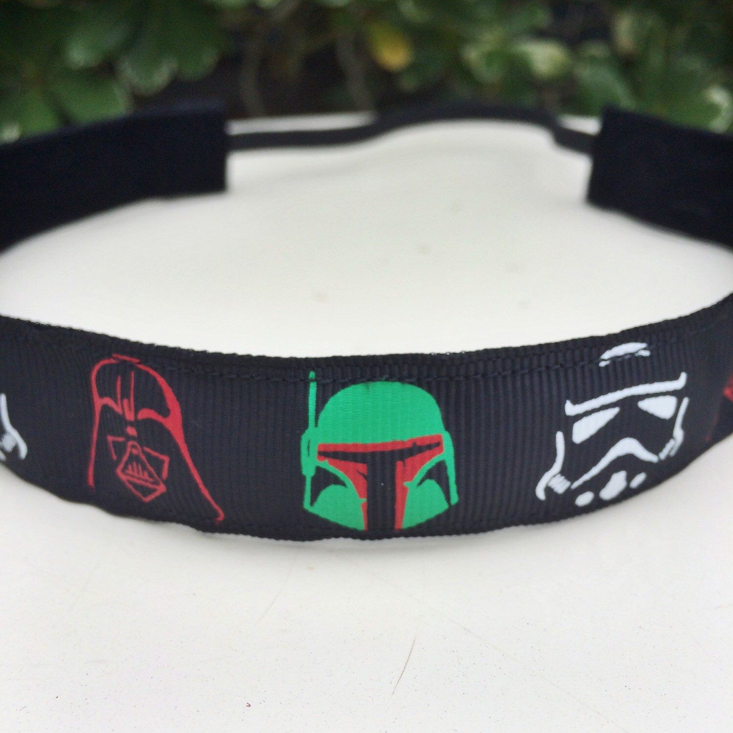 A personal favorite from my Etsy shop https://www.etsy.com/listing/270314895/star-wars-masks-running-headband-78