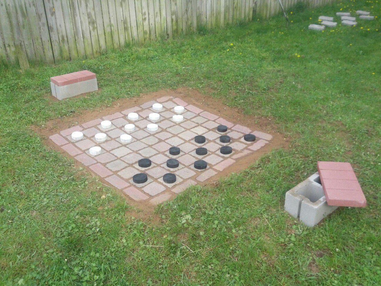 Back yard checkers. cinder block benches make great storage for ...