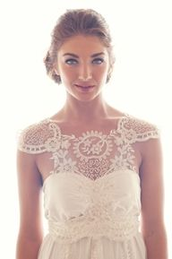 One of the most unique dresses I've ever seen but it would be glorious for a late spring / early summer wedding dress! So beautiful <3