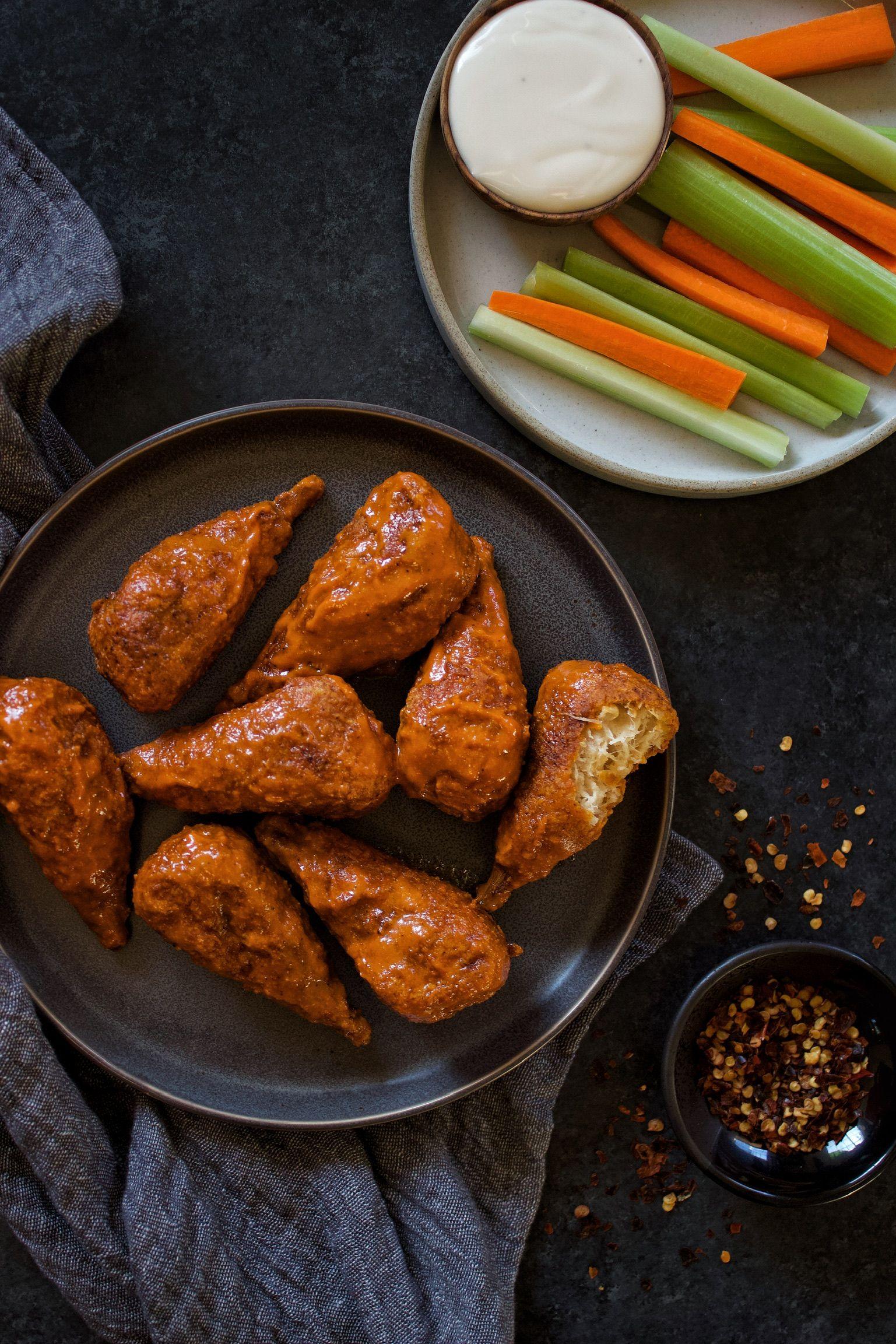 Crispy vegan wings in hot buttery buffalo sauce no