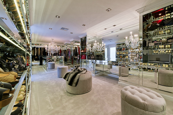 Extravagantly Luxurious Walk In Closet With Mirrored Cabinetry Shelves And Island