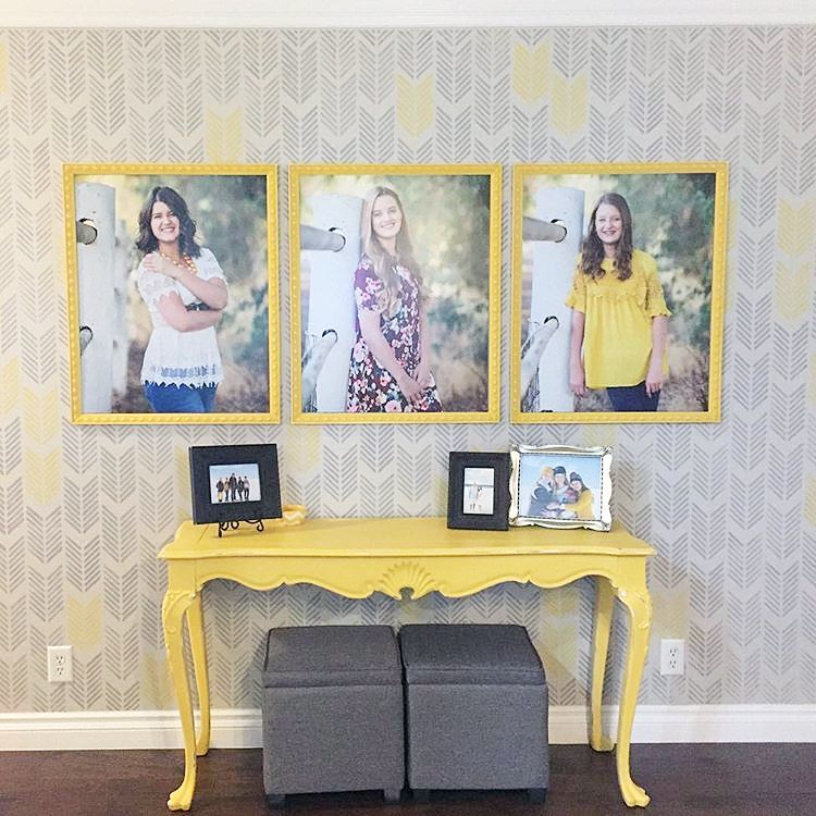 A gray and yellows stenciled accent wall using the Drifting Arrows ...