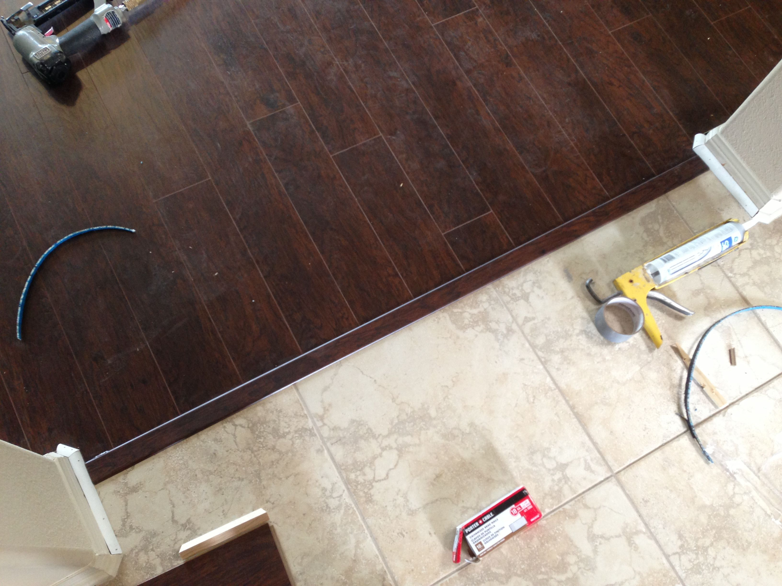 Tile transition to laminate tile floor kitchen for Hardwood floor tile kitchen