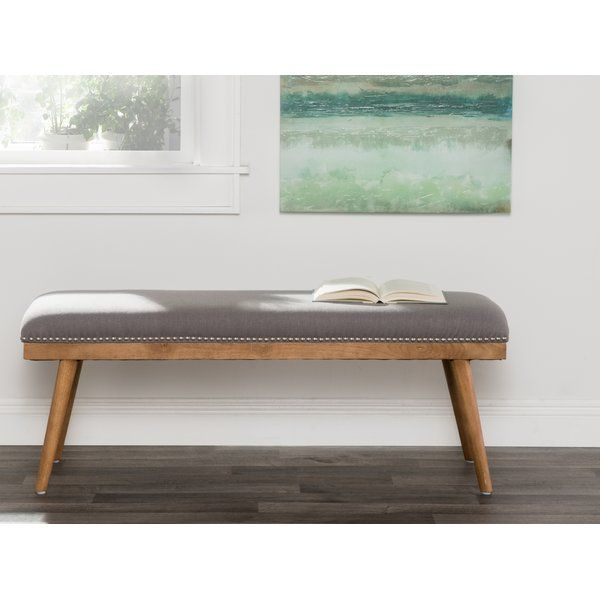 This Upholstered Entryway Bench Features Gray Upholstery And A