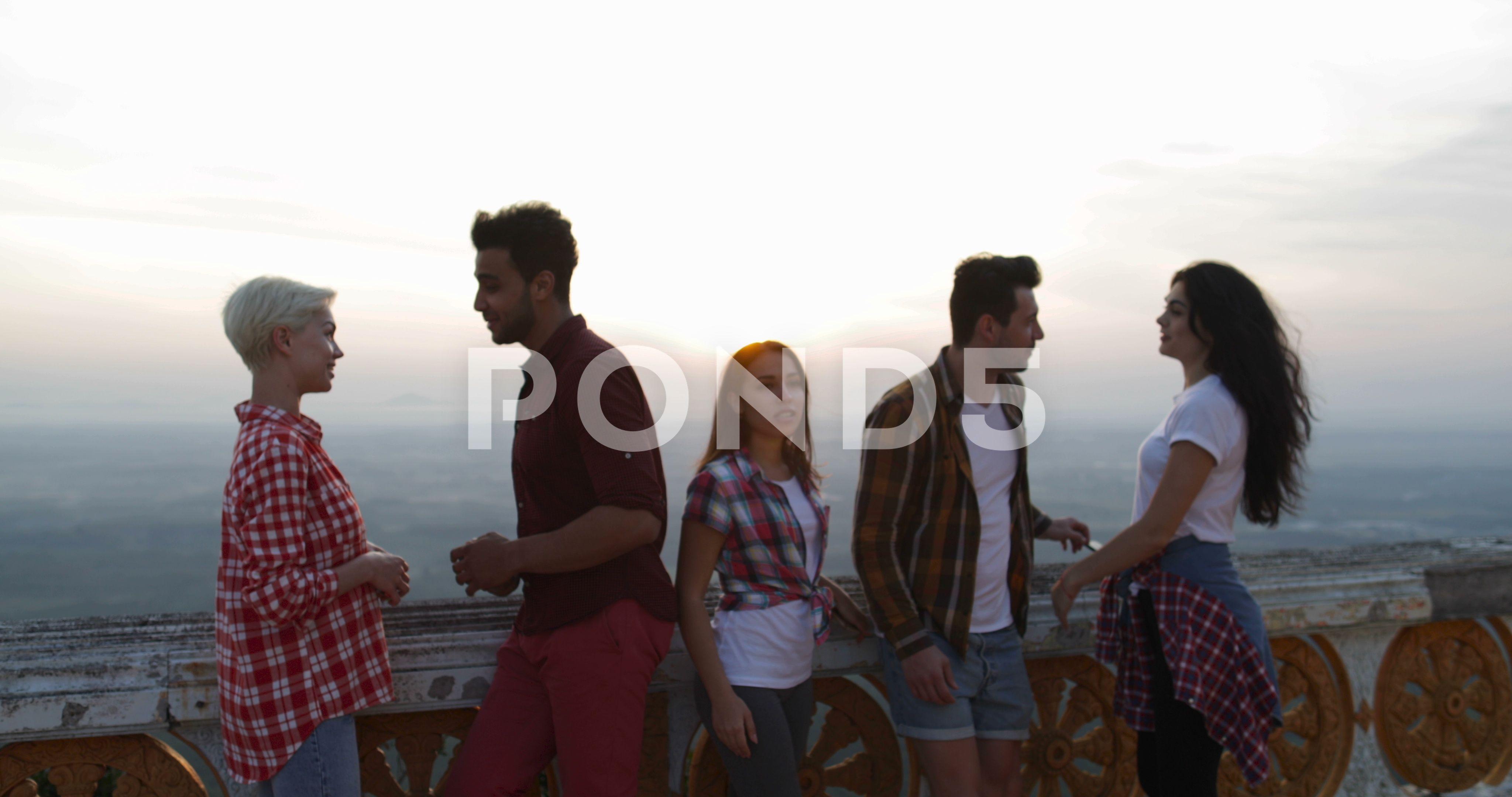 People On Mountain Top Talking At Sunrise Smiling Looking In Camera Friends Stock Footage TalkingSunriseTopPeople