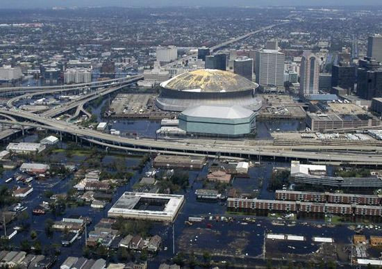 An aerial view from a United States Navy helicopter showing floodwaters around the Louisiana Superdome and surrounding area (2005). Description from sites.google.com. I searched for this on bing.com/images