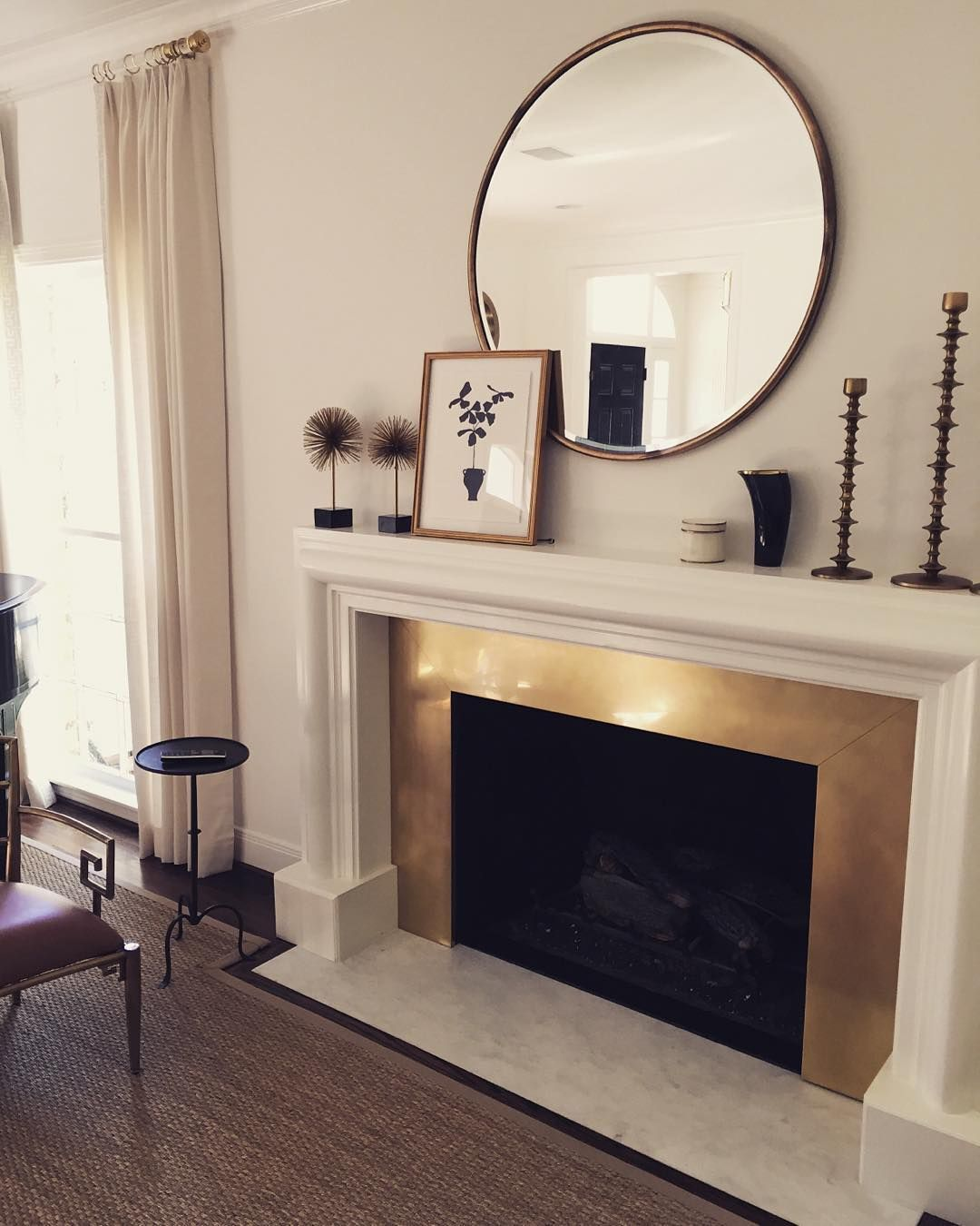 Brass fireplace surround via ladolcevitablog instagram fireside
