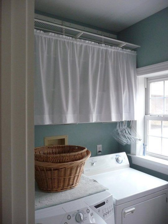 15 Uses For Tension Rods You Ve Never Thought Of Would Be Cute The Laundry Room With A Geo Pattern Fabric