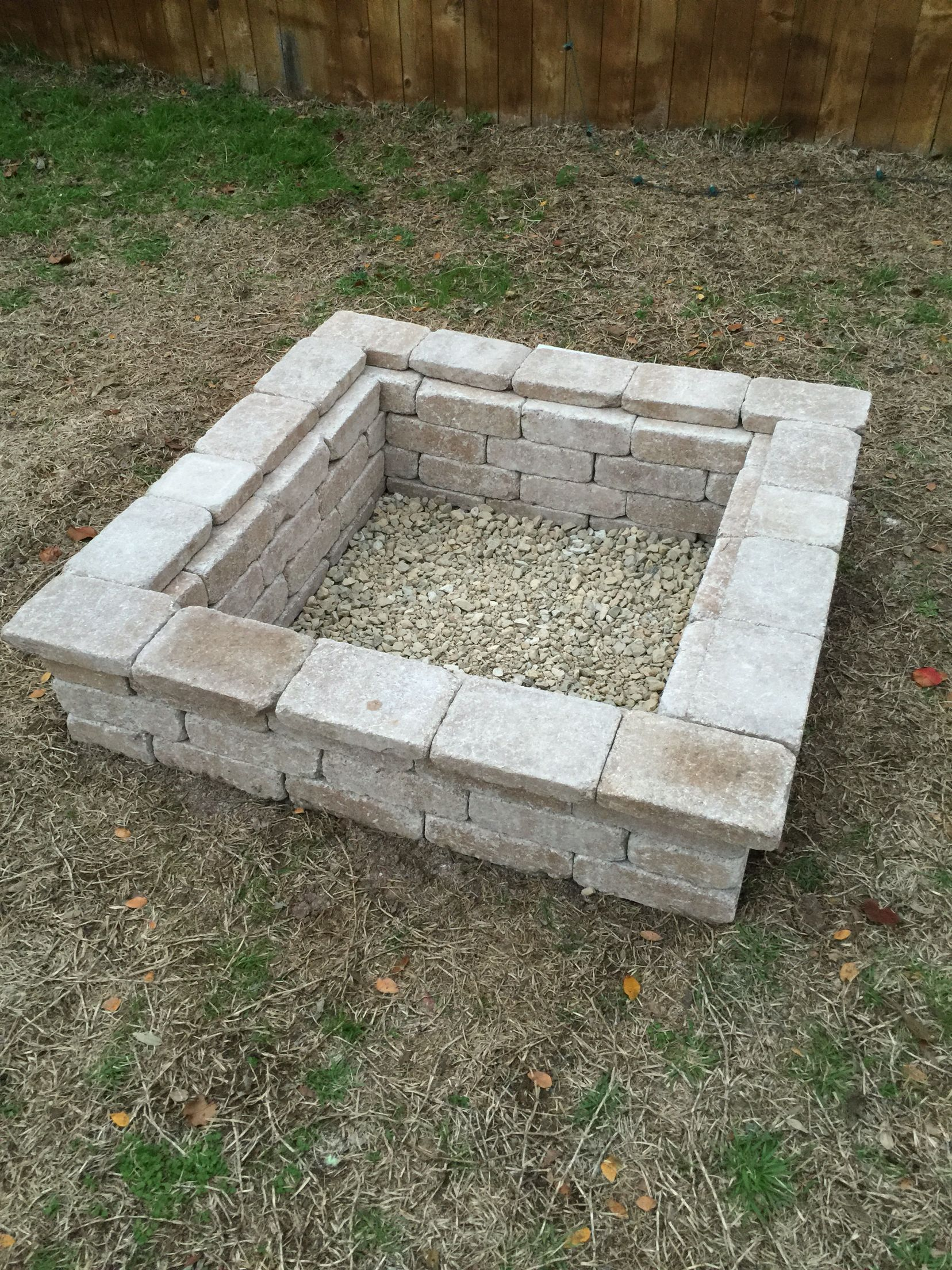 Our backyard firepit. 1. Dig a square hole six inches deep ...