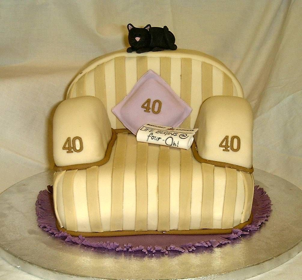 Striped armchair with newspaper cat made out of rich fruit cake