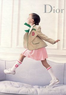 "Dior ad. Preppy young children's blazer with large pink ""D."""