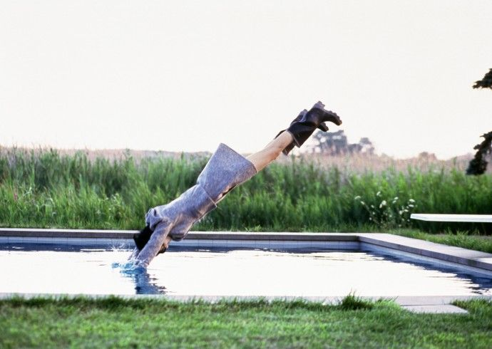Model Stella Tennant diving into the pool at the Houtenbos' house in Water Mill for a Vogue shoot