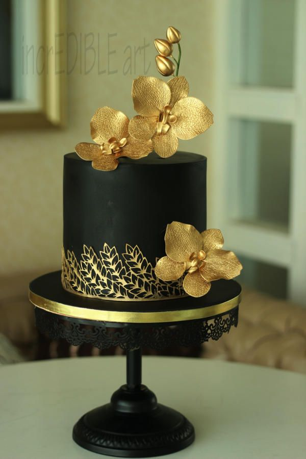 By Rumana Jaseel Black And Gold Single Tier Cake Flowers Piping