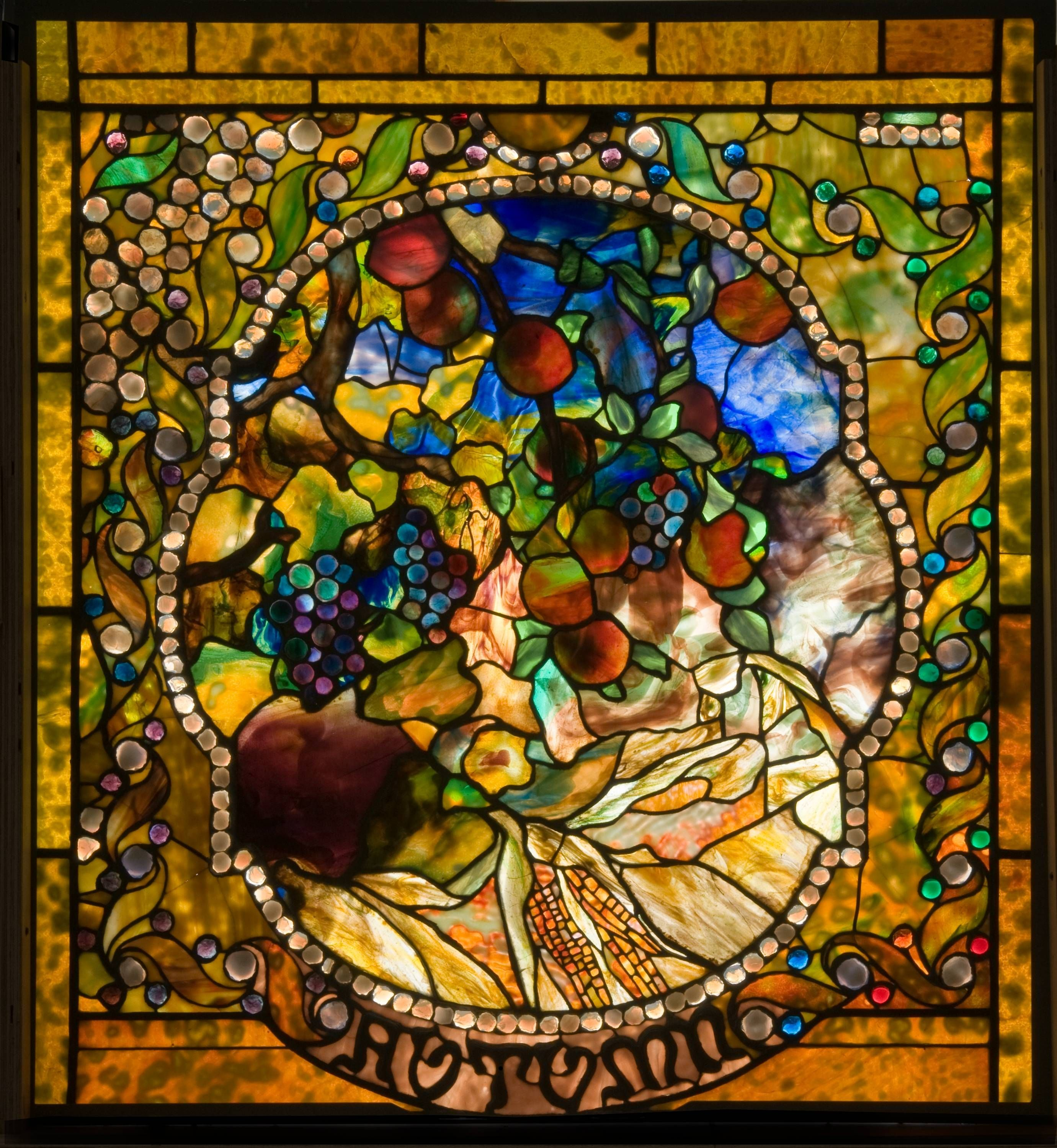 Salvaged from the Laurelton Hall living room, this is one of the Four Seasons window panels produced by Louis Comfort Tiffany c. 1899–1900. The four panels were exhibited at Exposition Universelle, Paris in 1900 and Prima Exposizione d'Arte Decoration Moderna in Turin, Italy in 1902 before being installed in Louis Comfort Tiffany's home.FALL