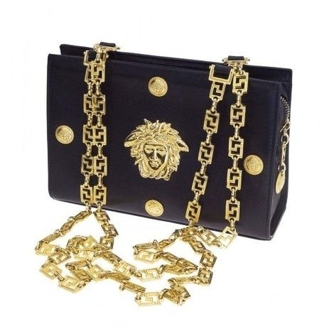 31d380ad8149f Beyonce Knowles wearing Versace Vintage Gianni Versace Couture Bag with Medusa  Motif.