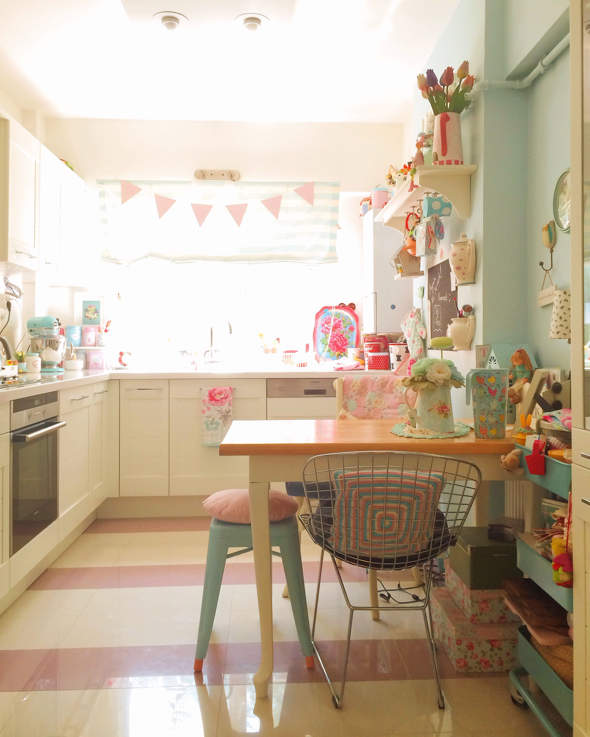 Mint green and pink vintage cottage kitchen.