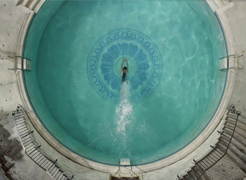 In baz luhrmann s the great gatsby jay gatsby s art deco style monogram adorns his pool as well for Jay gatsby fear of swimming pools