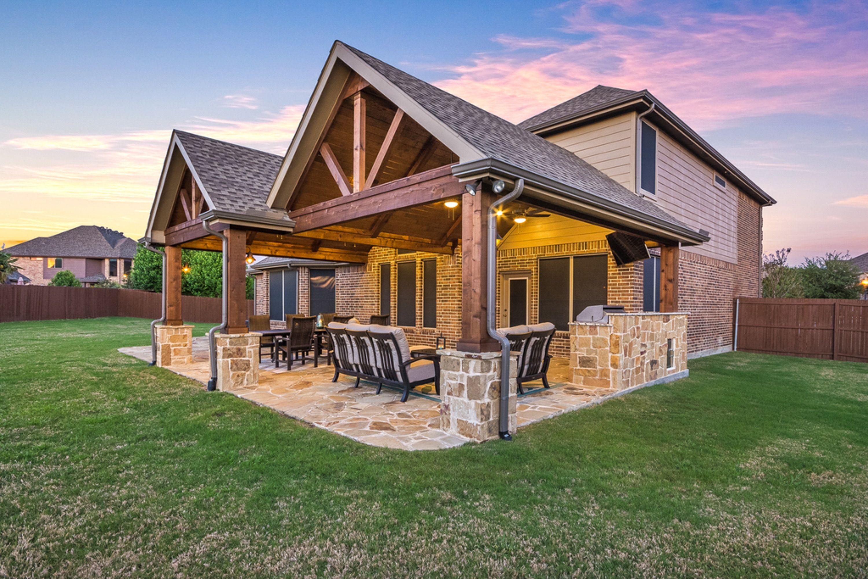 Double Gable Patio Cover With Outdoor Kitchen And Flagstone Flooring Patio Design Backyard Patio Designs Porch Design