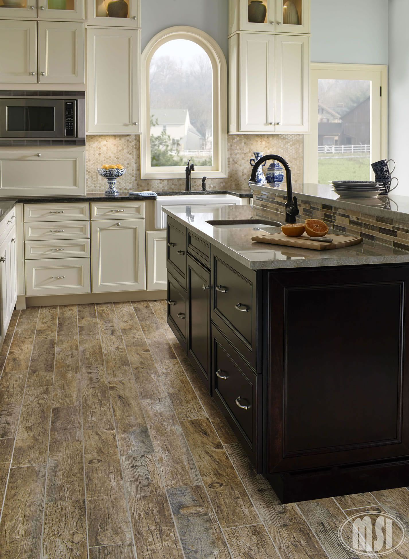 Perfect kitchen floor- no need to worry about real wood floors, Redwood  Natural 6X36