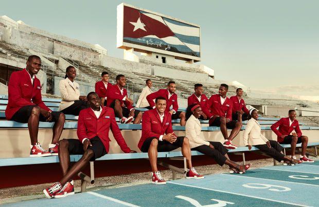 a12df2b78f Cuban Athletics Team Members at Estadio Panamericano beneath Cuban National  flag in Havana