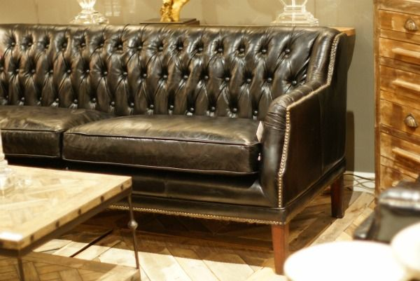 Leather tufted couch... yes please.