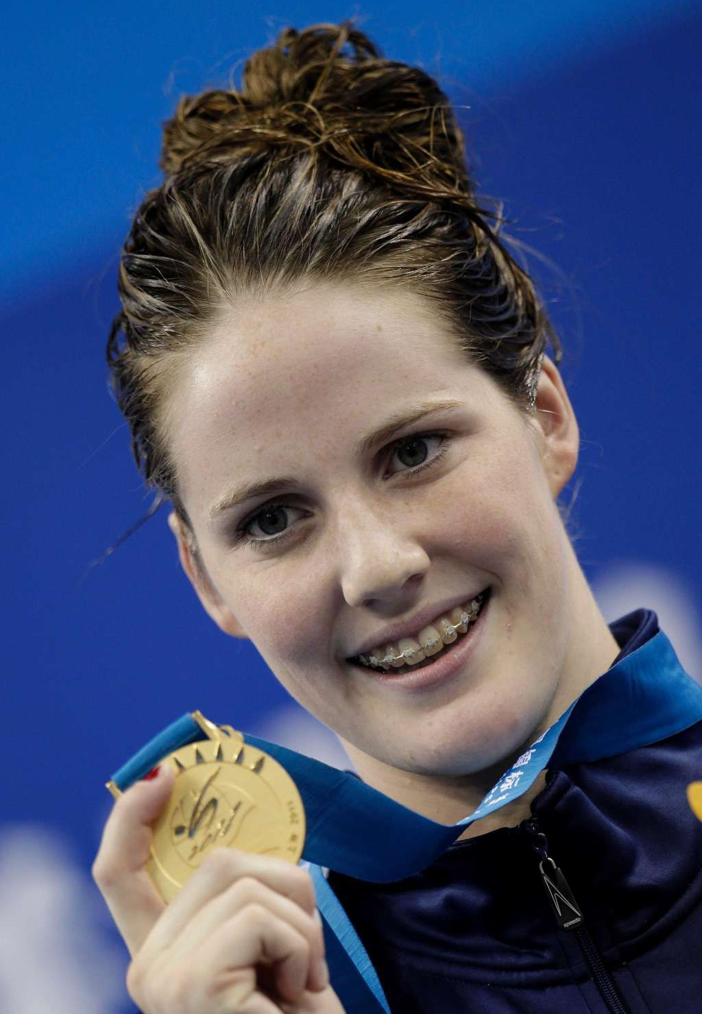 Missy Franklin Shows Off Her Ceramic Braces While Winning