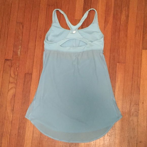 Powder Blue Lululemon Tank Super flattering fit. Powder blue color goes great with many skin tones. Slits cut in the built in bra (shown in 4th picture) to make room for a larger cup size. Size 4, great condition! lululemon athletica Tops Tank Tops