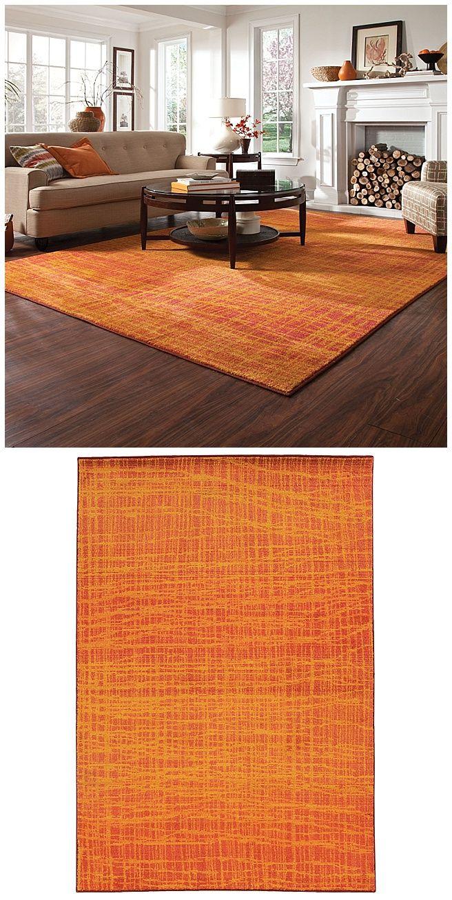 A beautiful burnt orange rug creates a striking statement