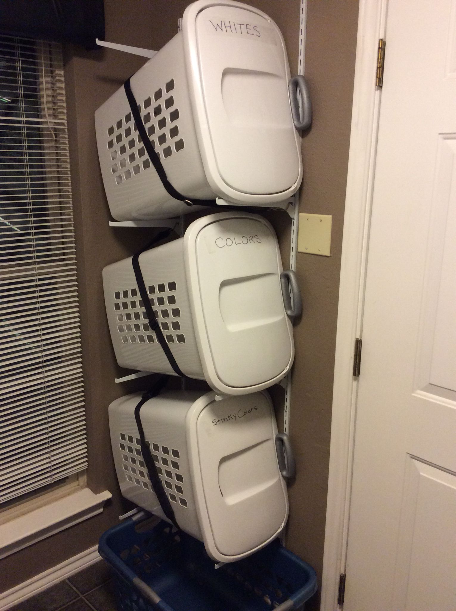 Laundry basket storage on wall