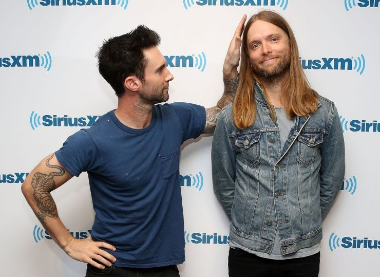 Adam Levine puts his hands all over the hair of his fellow Maroon 5 bandmate James Valentine on June 24 at SiriusXM Studios in New York