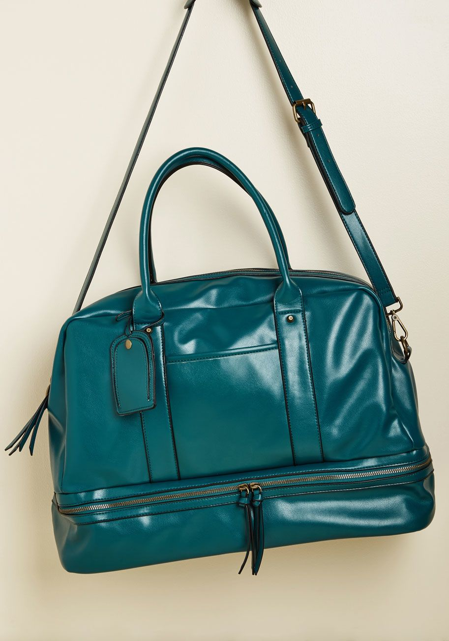 cb89a656602 Which came first - your action-filled schedule or this teal weekend bag   Comfortably toting everything you need for your next trip inside of its.