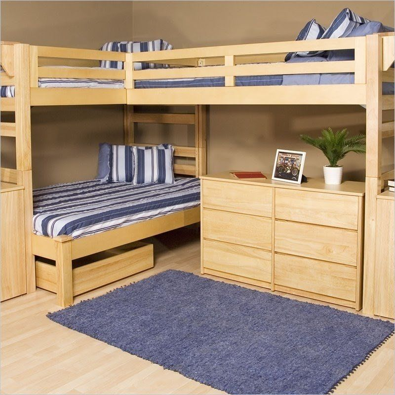 Constructed of sturdy wood, this triple bunk bed set is an
