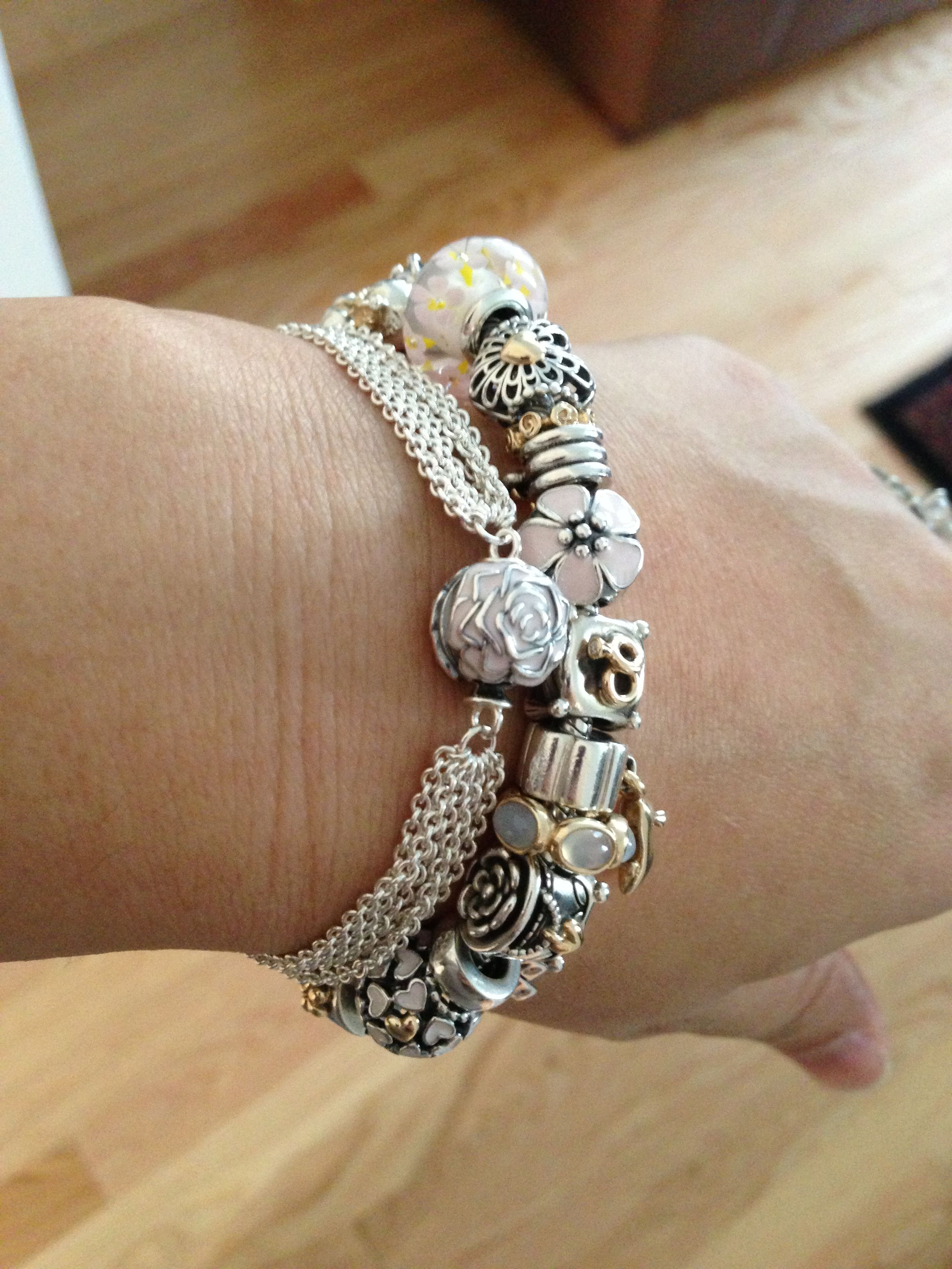 Lovely multiple strap bracelet with rose clip love to have this
