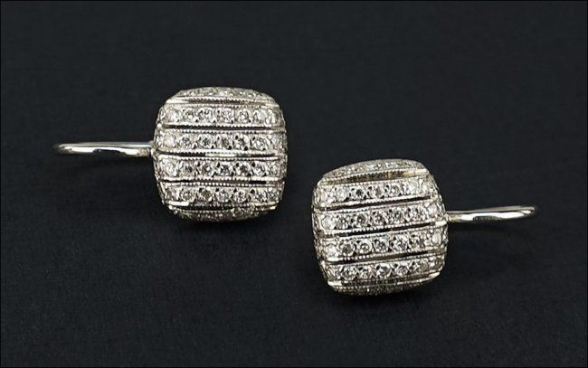 A Pair of Diamond and 18 Karat White Gold Earrings. Lot 165-7071