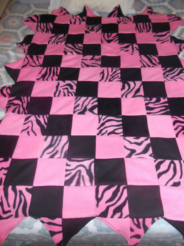 Zebra striped pink and black pieced fleece blanket by