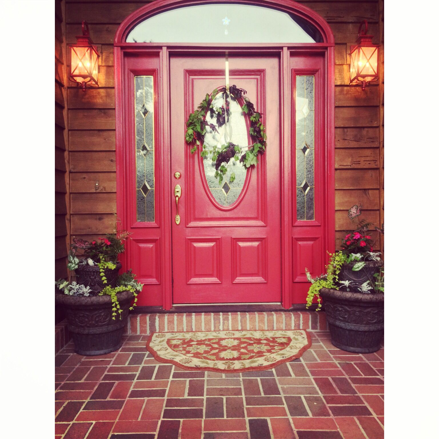 Simple way to add a quick make over to your front porch! Paint the door & light fixtures then add some colorful paints   Done by Katie Garner