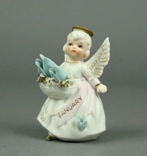 I have a very soft spot in my heart and in my shop for birthday angels! This one is bisque finished and is holding a basket trimmed with ceramic