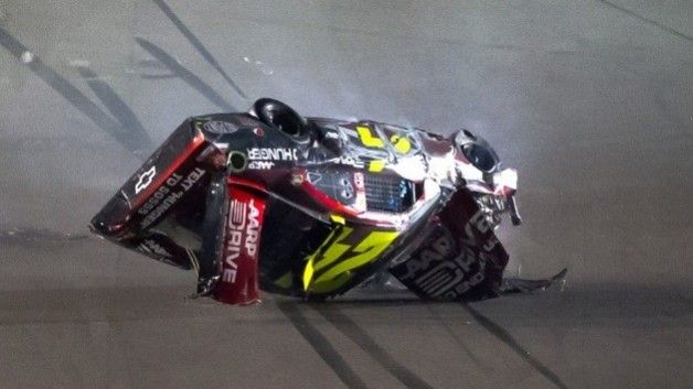 Jeff Gordon, driver of the #24 Drive to End Hunger Chevrolet, flips his car during the NASCAR Budweiser Shootout at Daytona International Speedway in Daytona Beach, Florida, on February 18, 2012.