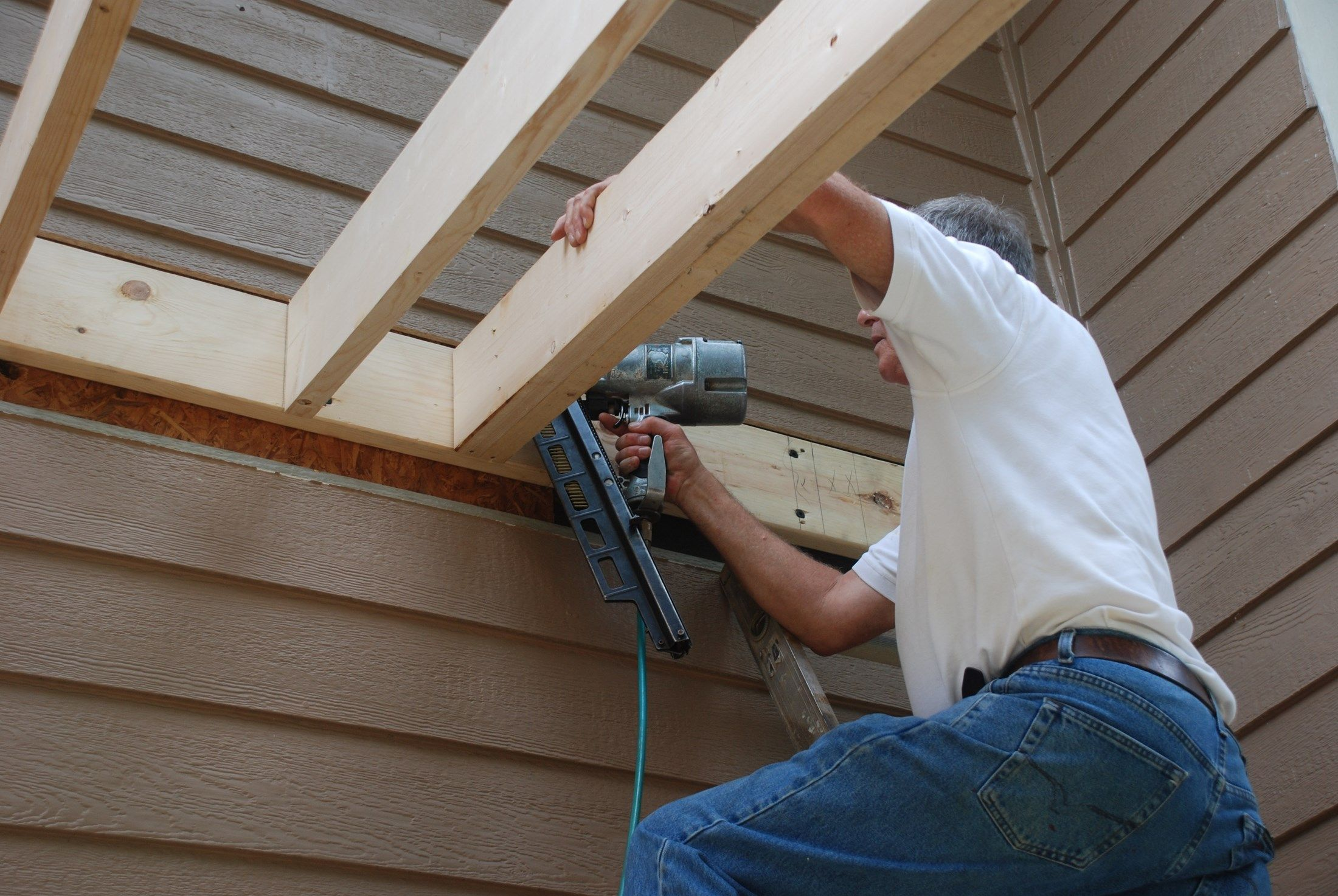 Learn How To Build A Shed Style Porch Roof Over Deck Building