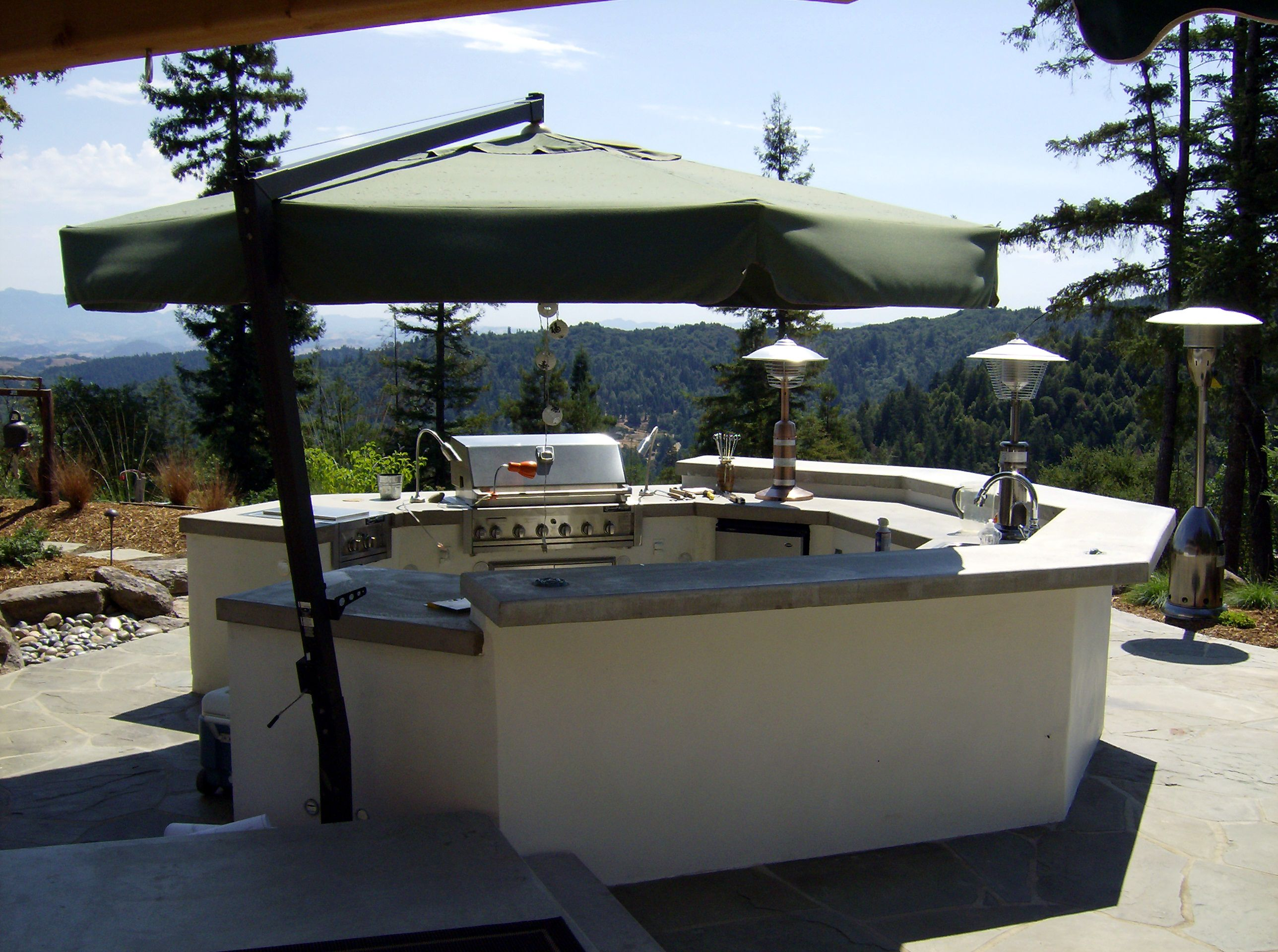 Octagonal Shape Mirrors House Architecture Stucco Finish With Poured In Place Concrete Countertop Outdoor Living Kitchen Outdoor Kitchen Design Octagon House