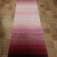 Häivyttämällä kudottu matto