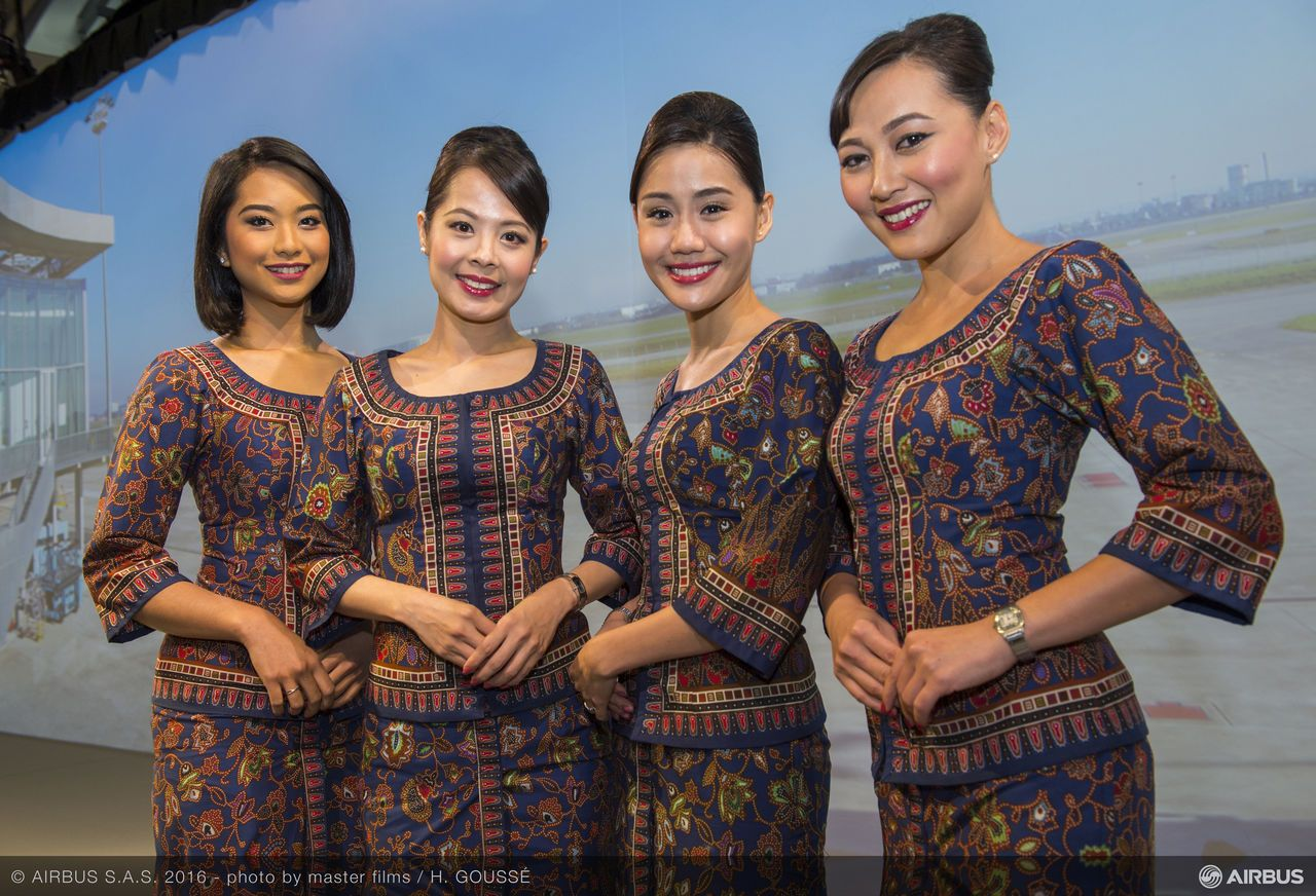 singapore international airlines strategy with a smile Singapore international airlines: strategy with a smile op yo mr cheong  choong kong, the ceo of singapore international airlines (sia) put away his  papers.