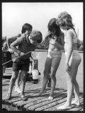 Group of Children Including Girls in Bikinis Inspect Their Net for Fish Fotografisk trykk