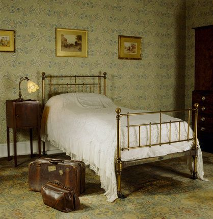 The Larkspur Bedroom At Standen With A Bed From Heals, An Old Leather  Suitcase And